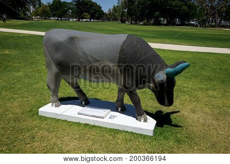 WESTERN AUSTRALIA, PERTH - NOVEMBER 2016: Shades of Grey cow at Supreme Court Gardens as part of CowParade event