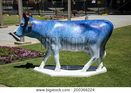 WESTERN AUSTRALIA, PERTH - NOVEMBER 2016: Colorful Blue painted cow at Supreme Court Gardens as part of CowParade event