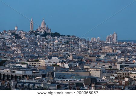 The Sacré-Coeur cathedral overlooking Paris from the hill at Montmartre