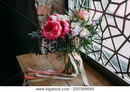 Rustic Wedding Bouquet With White Roses And Crimson Peonies On A Luxury Ornament Window. Indoors.
