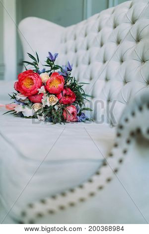 Rustic Wedding Bouquet With White Roses And Crimson Peonies On A Luxury Cream Sofa. Close-up. Side V