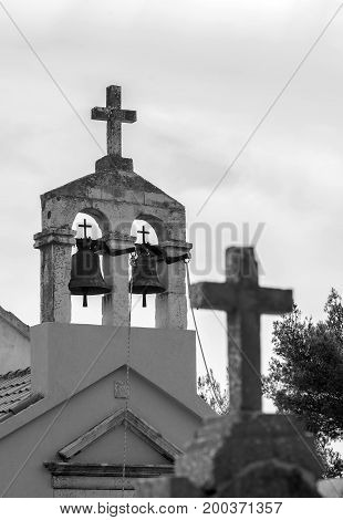 Meditteranian christian church with two small bells.