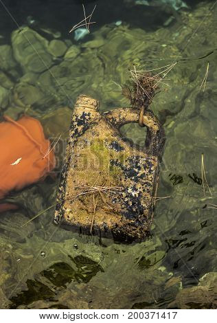 Plastic oil container floating on water for a long time
