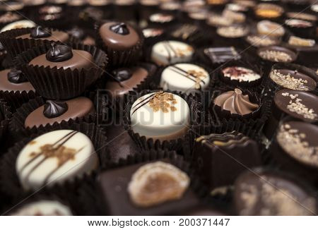 Small delicious chocolates deserts are stacked together.