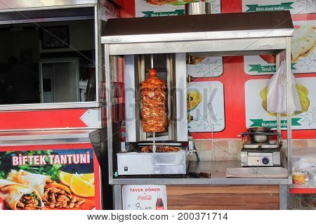 Meat is prepared in a special apparatus in a street cafe (Alanya, Turkey) in July, 2017.