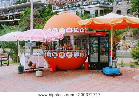 A kiosk with fresh juices and carbonated drinks on the city street (Alanya, Turkey) in July, 2017.
