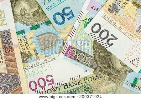Closeup of polish zloty banknotes. Financial background.