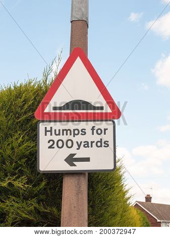 A Traffic Sign On A Post Outside Humps For 200 Yards Direction Pointer