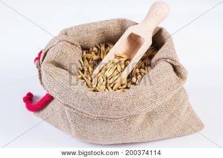 Heap Of Organic Oat Grains In Jute Bag, Healthy Nutrition, White Background