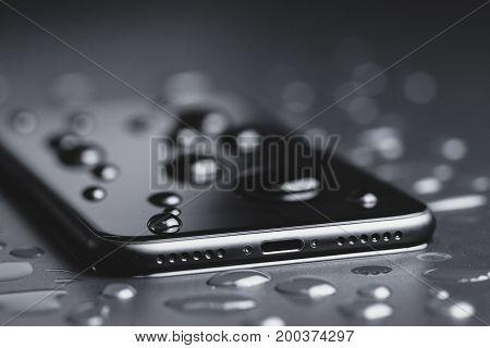 closeup phone be waterproof shot on black background