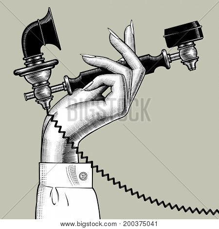 Woman's hand with retro black phone.  Vintage engraving stylized drawing