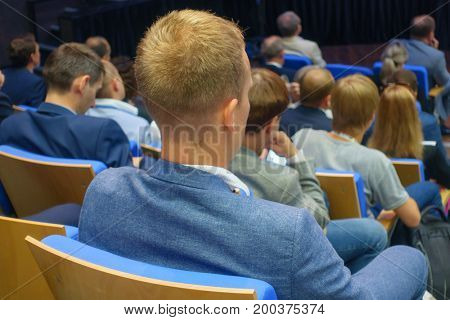 Audience at the conference, back view