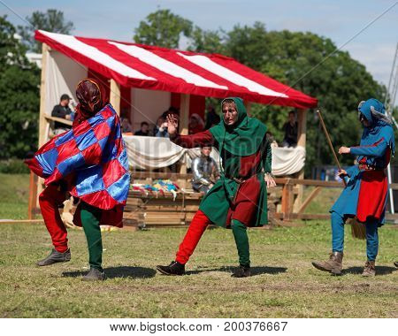 ST. PETERSBURG, RUSSIA - JULY 9, 2017: Group of buffoons performing before the tournament during the military history project Battle On Neva at St. Peter and Paul fortress. It's the 4th such an event