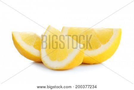 Slices of delicious lemon on white background