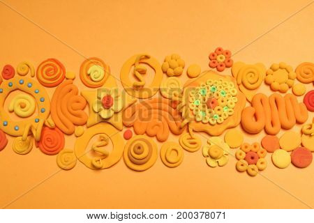 Color plasticine. Creative. Color plasticine on a orange background