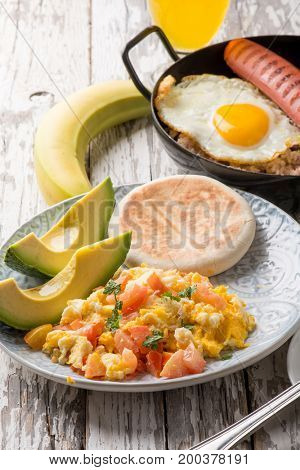 scramble eggs with arepas traditional colombian breakfast