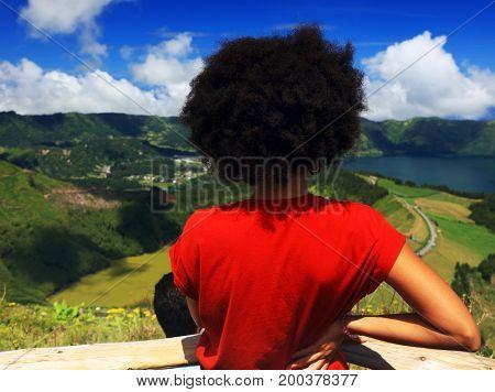 Young girl admiring the Sete Cidades landscape, Sao Miguel Island, Azores, Europe
