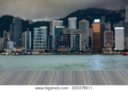 Opening wooden floor City of Hong Kong downtown blurred light night view abstract background
