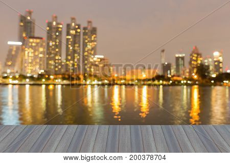 Opening wooden floor City office buildng blurred bokeh light water front abstract background
