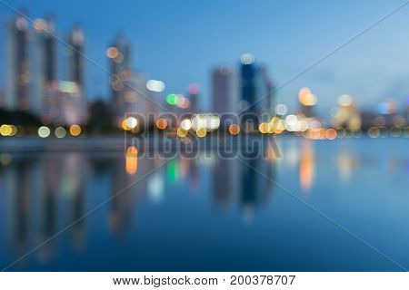Reflection blurred bokeh light city building night view abstract background