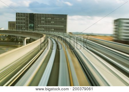 Moving motion blurred train track curved abstract background
