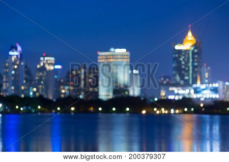 River front city blurred bokeh light night view abstract background
