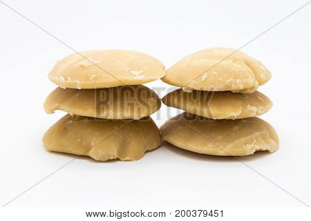 Raw palm sugar on white background Isolated
