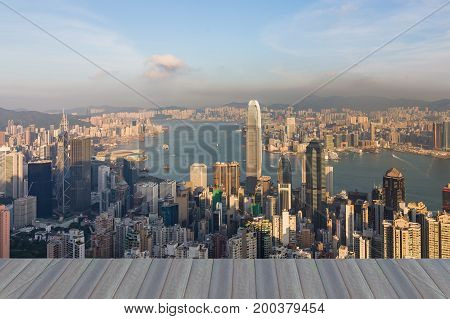 Opening wooden floor Aerial view Hong Kong central business downtown over Victoria Bay