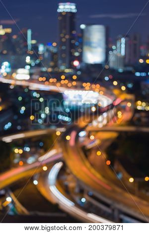 Blurred bokeh light night view highway intersection abstract background