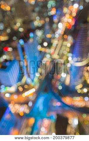 Aerial view blurred bokeh city downtown light cross over abstract background