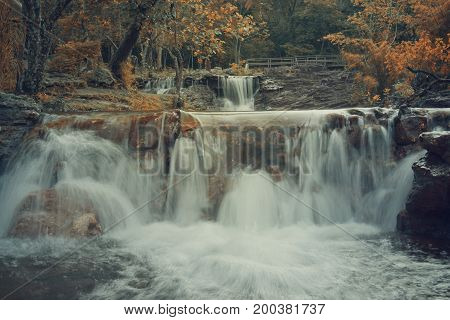 Landscape photo, Kam Hhom Waterfall, beautiful waterfall in Sakonnakhon province, Thailand