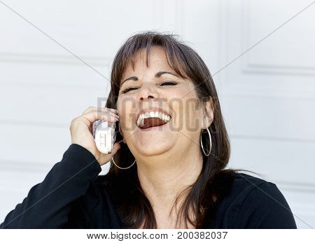 Attractive Woman Laughing While On The Phone