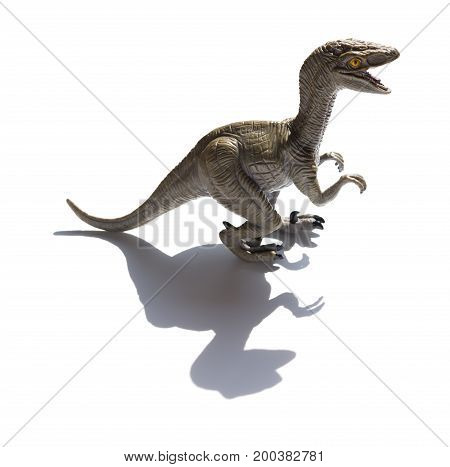 Deinonychus toy with shadow on a white background