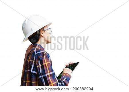 Young Asian engineer or architect woman wearing safety helmet and safety glasses use tablet on white background with clipping path for construction concept.