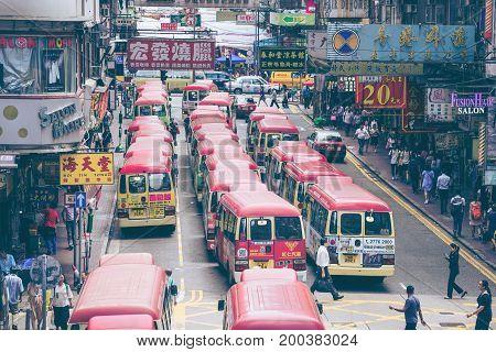 Hong Kong China - August 14 20157: Red Minibuses lining up waiting for passengers at a busy station in Mongkok Hong Kong