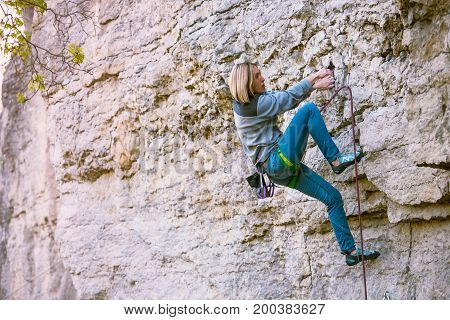 A Woman Climber On A Rock.