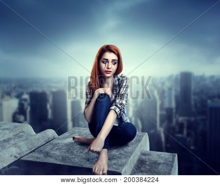 Woman crying on the roof, psychology stress