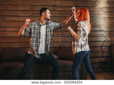 Man and woman quarrel, agressive couple fight