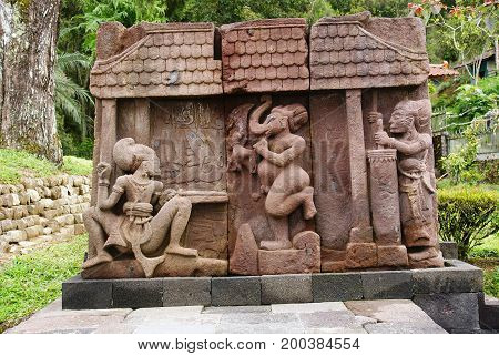 Stone sculpture and erotic bas-relief in Sukuh Temple, Central Java, Indonesia