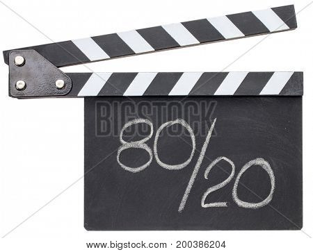 Pareto principle or eighty-twenty rule represented in white chalk handwriting on a black clapboard