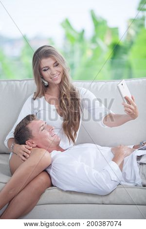 portrait of young couple  making self photo with mobile phone