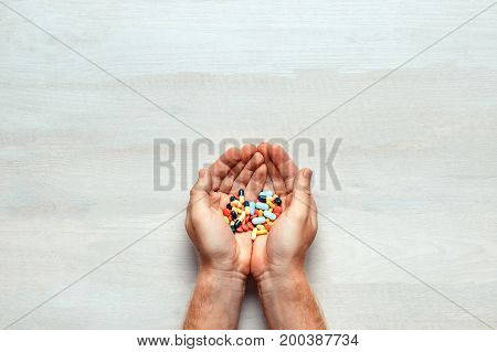 Many Colorful Pills On A Two Hands, Top View