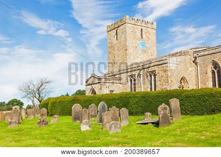 WHALTON, UNITED KINGDOM - AUGUST 7, 2012: A view of the largely medieval Parish Church of St. Mary Magdalene in Whalton. The church dates from the 13th Century having been developed from a previous Norman building.