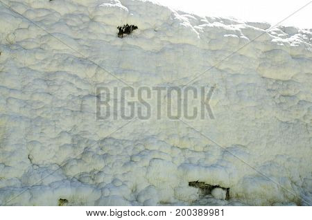 Walls of Pamukkale in Turkey Turkey. White hills in Pamukkale natural background. Pamukkale tourist location in Turkey