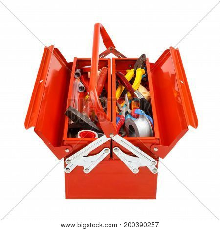 Open red metal tool box with tools and equipment isolated on white background.