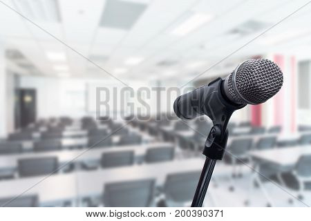 Microphone over the blurred business people forum Meeting Conference Training Learning Coaching Concept Blurred background