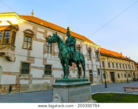 Budapest, Hungary - January 3, 2015: Old facade of historical house and sculpture in Buda Castle district. Buda Castle is the historical palace complex of the Hungarian kings, was first completed in 1265.