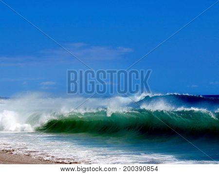 Body boarder in powerful shore break on Kaanapali Beach, Lahaina, Maui, Hawaii.
