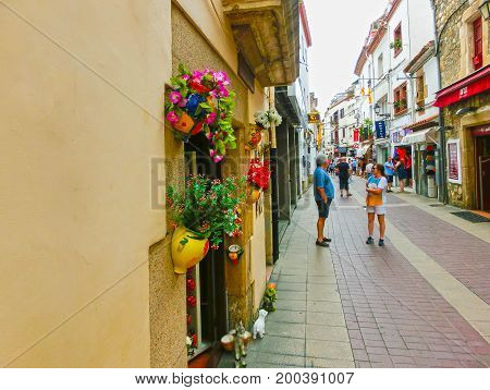 Tossa de Mar, Spain - September 14, 2015: The people going at old town Tossa de Mar in Costa Brava, Catalonia, Spain on September 14, 2015