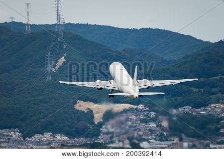 Airplane taking off from the Itami International Airport.